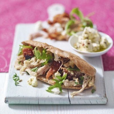Shredded pork pittas with crumbled feta and coriander